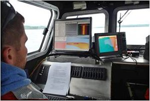 Alan Holcombe operates a multi-beam sonar system on Lake Superior