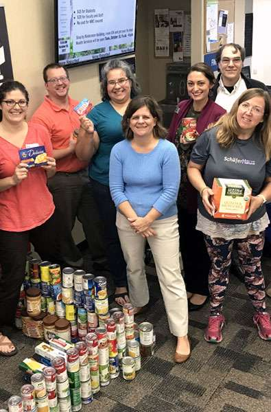 Photo of food pantry volunteers and donations